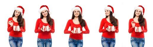 Attraktives Jugendlichmädchen mit einem Weihnachtsgeschenk Lizenzfreie Stockbilder