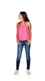 Attraktives junges Mädchen mit den Jeans, die zurück schauen Stockfotos