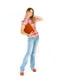 Attraktives Kursteilnehmermädchen mit großem Buch Stockbild