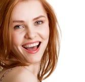 Attraktives lächelndes Frauenportrait Stockfoto