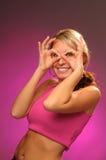 Attraktives Mädchen im Rosa stockfoto