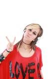 Attraktives Mädchen mit Kopfhörern lizenzfreie stockfotos