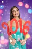 Attraktives Modell mit rotem Zeichen des neuen Jahres lizenzfreie stockfotografie