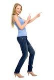 Attraktives Zeigen der jungen Frau Lizenzfreies Stockbild