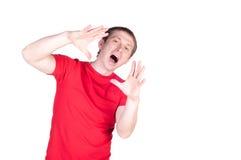 Attraktivt ropa för ung man Royaltyfria Foton