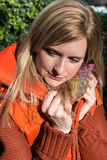 Attrative woman with warming waistcoat in autumn Royalty Free Stock Image