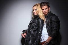 Attrative young fashion man holding his girlfriend Royalty Free Stock Images