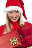 attravtive女孩存在圣诞老人 库存图片