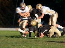 Attrezzatura dei giocatori di football americano durante il gioco Fotografia Stock