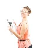 Attrezzatura della ragazza con i documenti sopra bianco Fotografia Stock