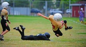 Attrezzatura di football americano della gioventù Fotografia Stock