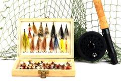 Attrezzatura di pesca con l'amo su fondo bianco Fotografie Stock