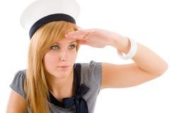 Attrezzatura di saluto del blu marino della giovane donna marina Fotografie Stock