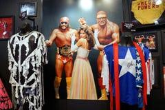 Attrezzature mega macho di poteri dell'uomo e di Hulk Hogan di leggenda di WWE, cappelli, s Fotografia Stock