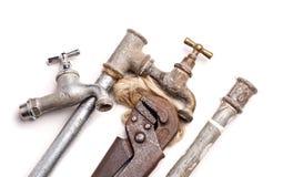 Attrezzi, impianto idraulico, tubi e rubinetti Fotografia Stock Libera da Diritti