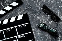 Attributes of film director. Movie clapperboard and sunglasses o stock photography