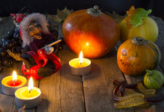 Attributes of Halloween. The attributes of Halloween - lit candles pumpkin witch toy gummi worms stock photos