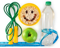 Attributes of a healthy lifestyle. Bottle of water, muesli and green apple. Attributes of a healthy lifestyle Royalty Free Stock Images