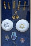 Attributes and symbols of judaism. Knitted jewish religious caps yarmulke, mezuzah and hamsa palm-shaped protective amulet royalty free stock image