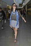 Attrice Emmy Rossum all'aeroporto di LASSISMO. fotografia stock