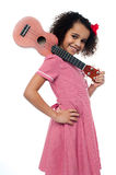 Atttactive school girl with toy guitar Stock Images