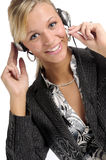 Atttractive blonde businesswoman with headphone Royalty Free Stock Photography