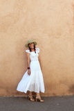 Atttractive woman in a white summer dress. Royalty Free Stock Photo