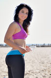 Atttractive woman working out on beach Royalty Free Stock Images