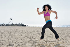 Atttractive woman working out on beach Royalty Free Stock Photo