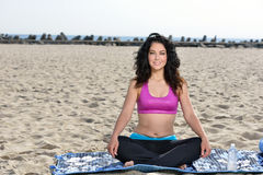 Atttractive woman working out on beach Stock Photography