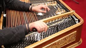 Attunes a cimbalom stock footage