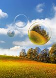 Atumn Bubbles. Stunning light and Colour at An abandoned playing Field and Park covered with leaves and three bubbles in Northumberland, England Royalty Free Stock Image