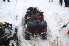 ATV在冬天 图库摄影