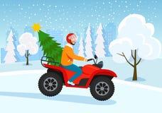 Atv молодого человека ехать с рождественской елкой над зимой валов снежка съемки ландшафта пущи бесплатная иллюстрация