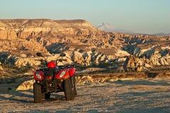 ATV на краю каньона Стоковое Изображение