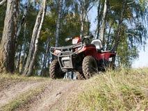 ATV на холме около леса осени стоковые фотографии rf