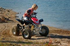 ATV. Young boy riding ATV for fun Stock Photos