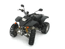 ATV Black All Terrain Vehicle on white snow. Background Royalty Free Stock Image