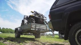 A sports ATV in a car trailer. Transportation of an off-road ATV in a trailer stock video