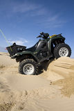 ATV conquers hill Royalty Free Stock Photography