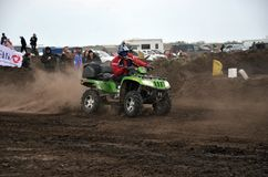 ATV cross rider in movement royalty free stock image
