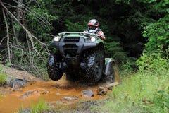 ATV dans la crique Image libre de droits