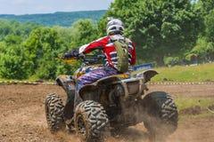 ATV-de raceauto neemt een draai Stock Afbeeldingen