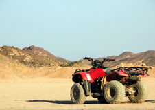 ATV in the desert against the background of the mountains. Safari on quad bikes. Egypt, May 2012 year royalty free stock image