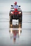 ATV driver on the beach Royalty Free Stock Photo