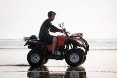 ATV driver on the beach. Happy ATV driver on the Ninety Mile Beach, New Zealand Royalty Free Stock Photos