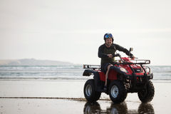 ATV driver on the beach. Happy ATV driver on the Ninety Mile Beach, New Zealand Royalty Free Stock Photos