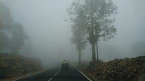 Atv en el camino de niebla en el teide Fotografía de archivo