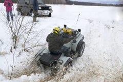 ATV en el invierno Imagen de archivo libre de regalías