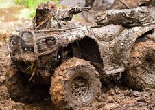 ATV Enduro. Vehicle racing in the mud during a dirt track race Stock Images